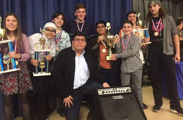 debate team with trophy