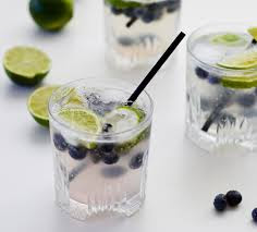 cocktail with blueberries and lime